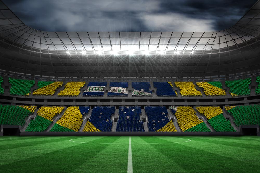 Digitally generated brazilian national flag against large football stadium